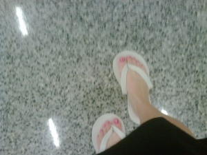 Laura Cotton shuffles through DFW airport in spa slippers